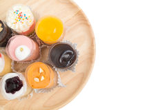 Small cup cakes on wooden tray Royalty Free Stock Photography