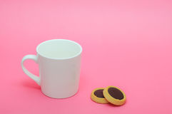 Small Cup Of Coffee On Pink Blackground. Empty White Small Cup Of Coffee And Cookies On Pastel Pink Background Royalty Free Stock Photos