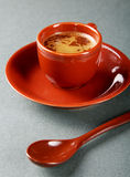 Small cup of coffee with a spoon Stock Photos