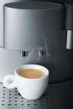 Small cup of hot espresso in automatic coffee machine Royalty Free Stock Photos