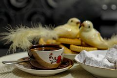 Small cup of hot turkish coffee with cookies on table stock photo