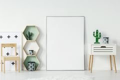 Small cupboard with cactus shaped lamp and decorationsative box Royalty Free Stock Images