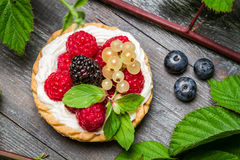 Small cupcake with berry fruits Royalty Free Stock Image