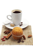 Small cupcake and cup of coffee Stock Photos