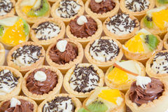 Small cupcakes with different stuffing Stock Images