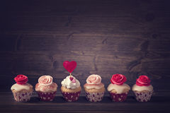 Small cupcakes with roses Stock Photography