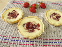 Small curd cheese cakes with strawberry jam Stock Photos