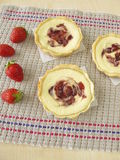 Small curd cheese cakes with strawberry jam Stock Images