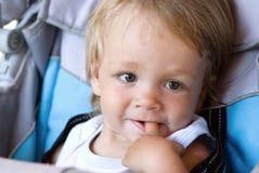 Small curious boy in a carriage Stock Photos