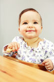 Small cute baby eating stock image