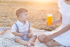 Small cute baby with his mother on a picnic. Stock Photography
