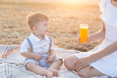 Small cute baby with his mother on a picnic. Royalty Free Stock Photography