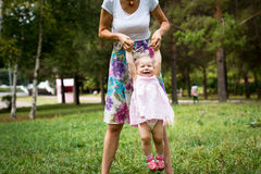 Small cute baby and nice mom Stock Images