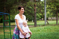 Small cute baby and nice mom Stock Photography