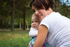 Small cute baby and nice mom Royalty Free Stock Photos