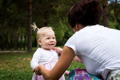 Small cute baby and nice mom Royalty Free Stock Image