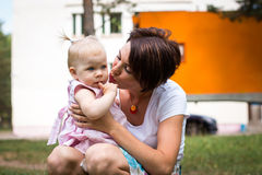 Small cute baby and nice mom Stock Photos
