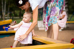 Small cute baby and nice mom Royalty Free Stock Images