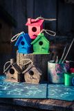 Small and cute bird feeder and blue construction plan. Closeup of small and cute bird feeder and blue construction plan Stock Image