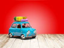 Small retro travel car on floor Royalty Free Stock Images
