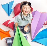 Small cute boy with plenty toy planes royalty free stock images