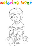 Small cute boy riding a bicycle Royalty Free Stock Image