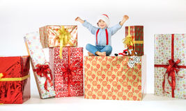 Small cute boy sitting on the gift Royalty Free Stock Images