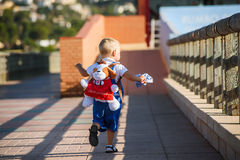 Small cute boy is walking Royalty Free Stock Images