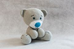 Small cute crochet bear toy. Royalty Free Stock Images
