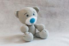 Small cute crochet bear toy. Stock Photo