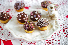 Small cupcakes with chocolate ganache and sprinkles Stock Photo
