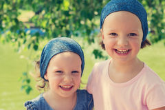 Small cute funny girls (sisters) laugh. Selective focus. Stock Image