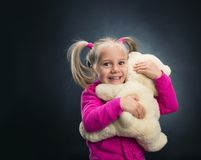 Small cute girl holds toy bear Royalty Free Stock Photos