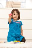 Small cute girl offering building block Royalty Free Stock Photo