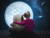 Small cute girl sitting with toy bear Stock Photos