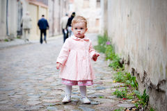 Small cute girl standing in the street Royalty Free Stock Images