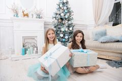 Small cute girls received holiday gifts. Best toys and christmas gifts. Kids little sisters hold gifts boxes interior. Background. Children friends excited royalty free stock photo