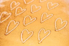 Hearts drawn on bright golden glitter stock photos