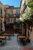 Small cute italian restaurant outside in patio of Stock Photos