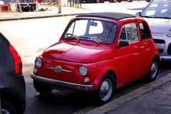 Small cute italian vehicle. Good quality photo oa a typical italian car. You may see beautiful tiny retro vehicle with soft convertible top. Everybody loves this Stock Photo