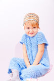 Small cute kid in knitted blue dress Stock Photography