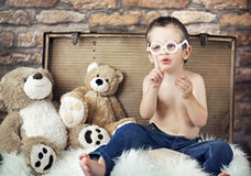 Small cute kid with teddybears Stock Photo