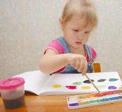 Small cute painting girl Stock Photography