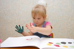 Small cute painting girl Stock Photo