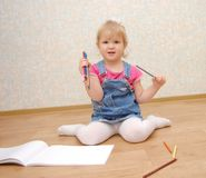 Small cute painting girl at home Stock Photos