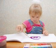 Small cute painting girl at home Royalty Free Stock Photo