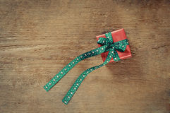 Small cute present box for Christmas on old wooden background Stock Image