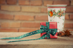 Small cute present box and cup of tea with cinamon for Christmas Royalty Free Stock Photography
