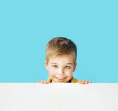 Small, cute smiling boy making faces Stock Photography