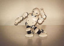Small cyborg robots, humanoids with face and body dances to music Royalty Free Stock Image